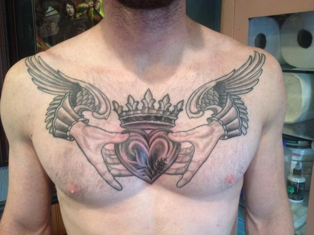 Heart in Hands Chest Piece Tattoo - Blackwood Tattoo Studio